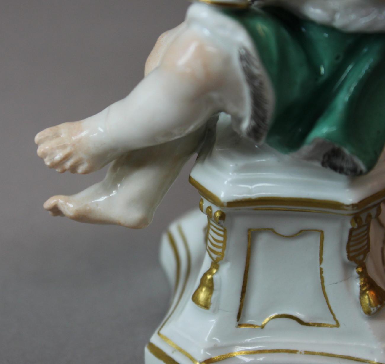 Restauration d'une figurine de l'Hiver