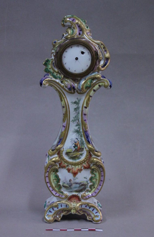 Restauration d'un porte montre ancien en faïence de Rouen