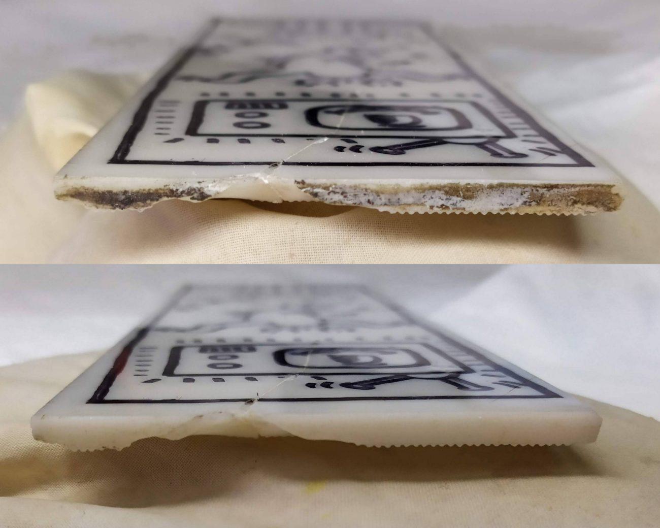 Restauration d'une plaque de verre en opaline de Keith Haring